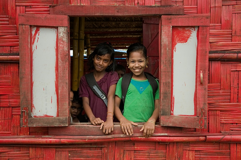 Children in Bangladesh smile.