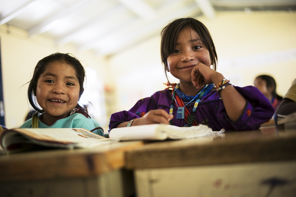 Children sit in a classroom in Mexico.