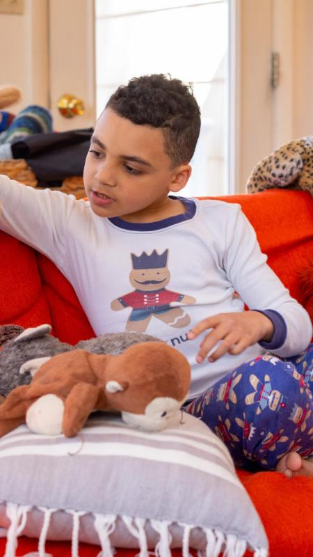 Child playing with stuffed animals.
