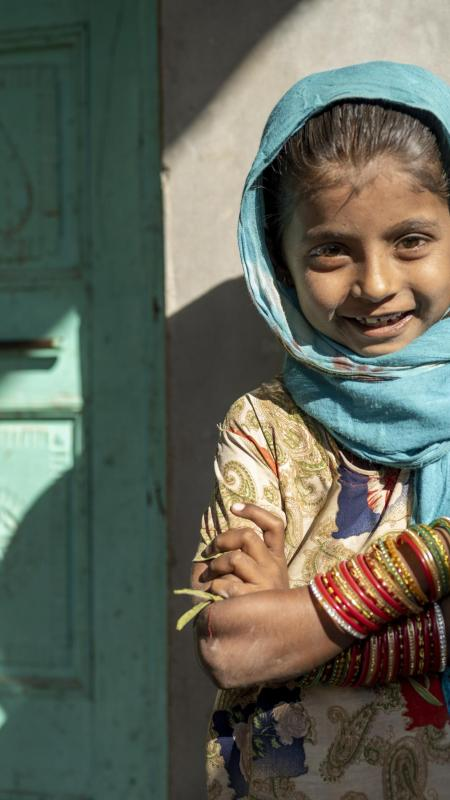 A girl smiles in India.